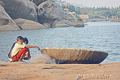 Indian Boys near the boat  fishing Editorial Photography