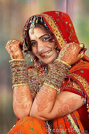 Indian bride in her wedding dress showing bangles