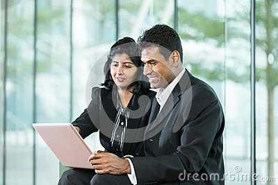 Indian Business team using digital tablet.