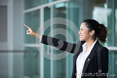 Indian business woman pointing to distance