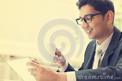 Indian businessman using a tablet computer