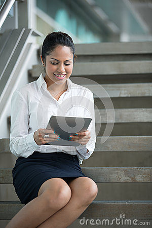 Indian Businesswoman reading her digital tablet.
