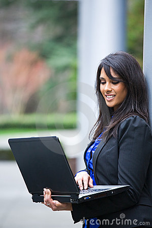 Free Indian Businesswoman With Laptop Royalty Free Stock Photography - 8459937
