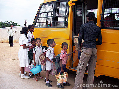 Indian children getting on school bus Editorial Stock Photo