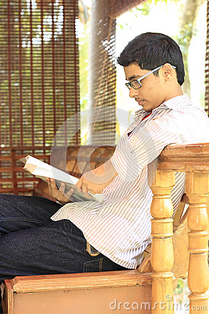 Indian College Student Reading Textbook