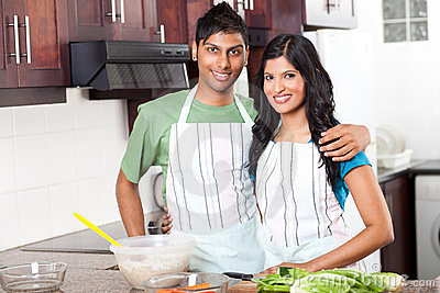 Indian couple in kitchen