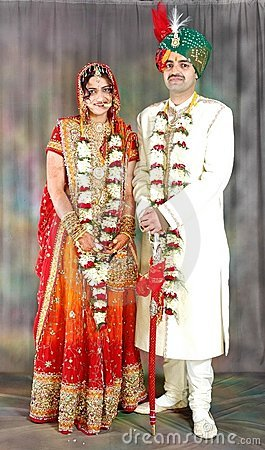 Indian couple in their wedding dress Stock Photo