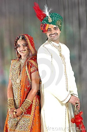 Indian couple in wedding attire Stock Photo
