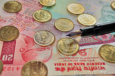 Indian Currency and Coin with a fountain pen
