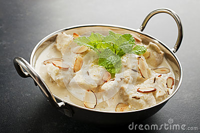Indian Curry Chicken Korma on a Dark Background