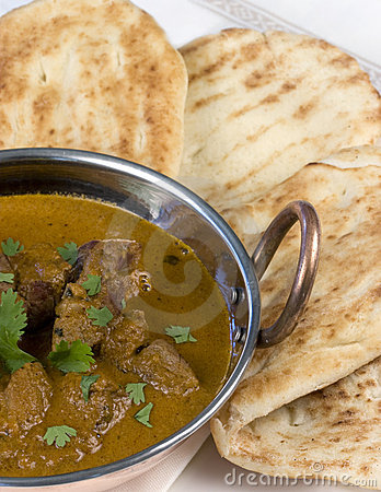 Indian Curry with Naan Bread - vertical