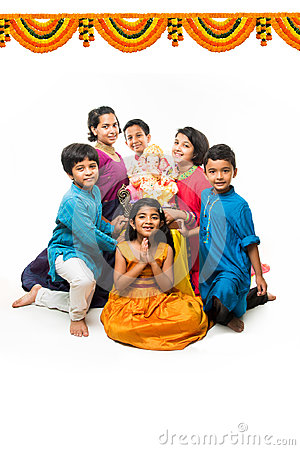 Free Indian Cute Kids Holding Statue Of Lord Ganesha Or Ganapati On Ganesh Festival Or Chaturthi, Welcoming God. Asian Small Boys And G Royalty Free Stock Images - 97849559