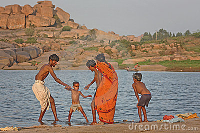 Indian family near the river Editorial Stock Image