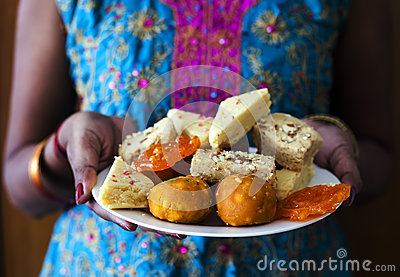 Indian Female Carrying Indian Diwali Sweets