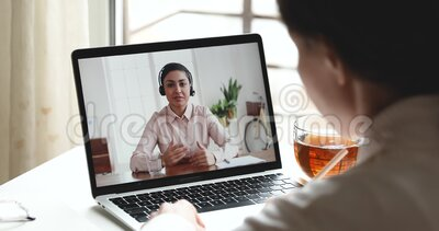 Indian female manager wearing headset consulting customer by webcam videocall. Indian female online teacher, customer service support manager wearing headset stock video footage