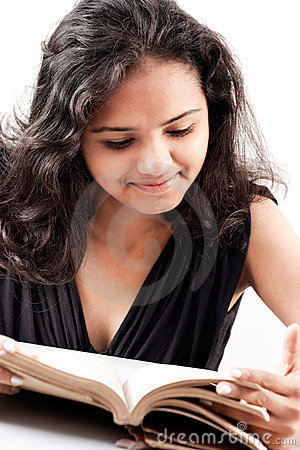 Indian girl enjoing reading book