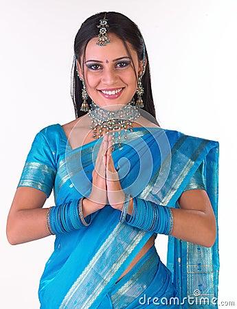 Free Indian Girl Saying Namaste Stock Image - 7811291