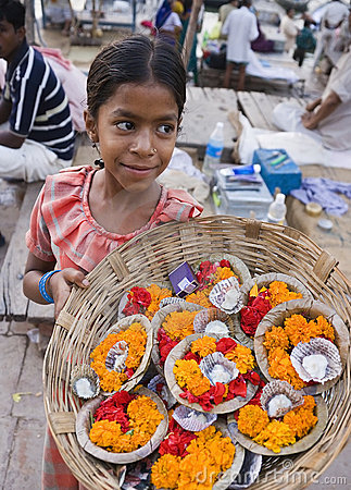 Indian girl selling offerings - Varanasi - India Editorial Stock Photo