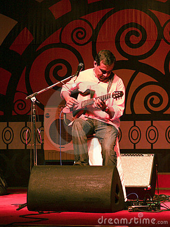 An Indian guitarist playing live in concert Editorial Stock Photo