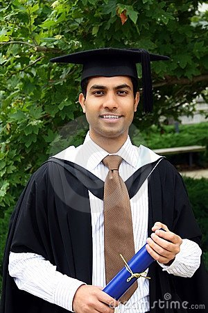 Indian guy in a graduation gown.