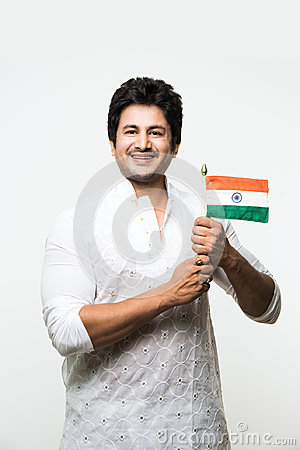 Free Indian Handsome Boy Or Man In White Ethnic Wear Holding Indian National Flag And Showing Patriotism, Standing Isolated Over White Stock Photos - 97608323
