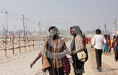 Indian holy men walking Editorial Stock Image