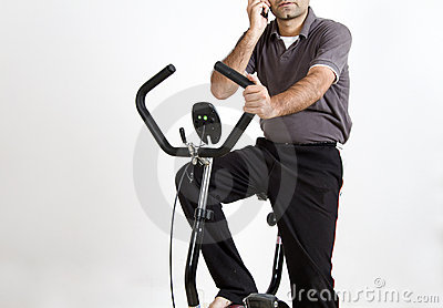 Indian Man Exercising and Speaking on Phone