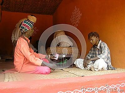 Indian man fortune-teller parrott  statue Editorial Photo