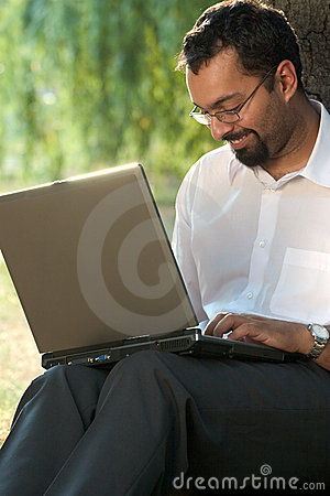 Indian man with a laptop