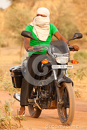 Indian man on Motorbike Editorial Photo