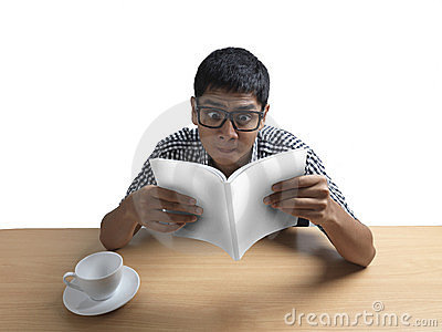 Indian Man reading book amazed