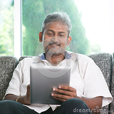 Free Indian Man Using Digital Tablet Computer Royalty Free Stock Photography - 41652927