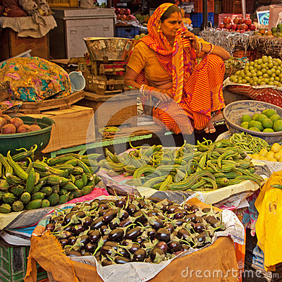 Indian market trader and wares editorial stock image for City indian dining ltd t a spice trader