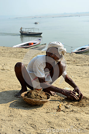 Indian Old Man Collecting Cow Shit Editorial Image