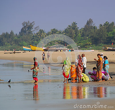Indian people on the beach at Gokarna Editorial Stock Image