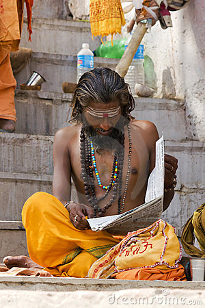 Indian Sadhu reading news paper Editorial Stock Photo