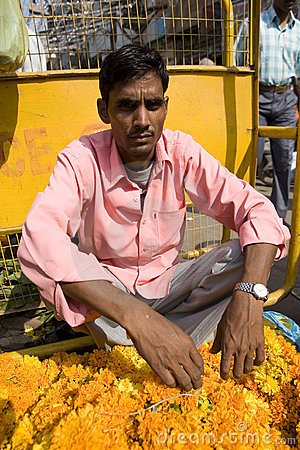 Indian seller of flowers. Editorial Photography