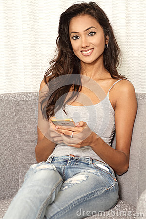 Free Indian Student Girl Using Mobile Phone Device Royalty Free Stock Photo - 84384115