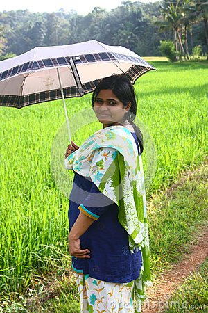 Indian Village Girl Holding Umbrella in Sunlight