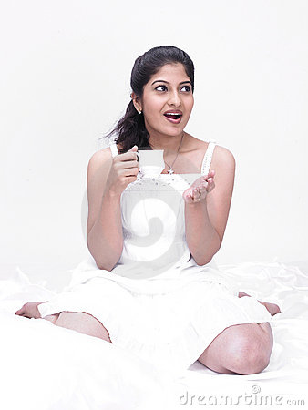 Indian woman drinking her tea