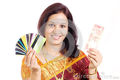 Indian woman holding currency note and credit card