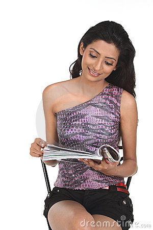 Indian woman with magazine