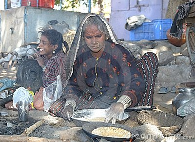 Indian woman is making chapati Editorial Photography