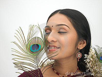 Indian woman with peacock feather