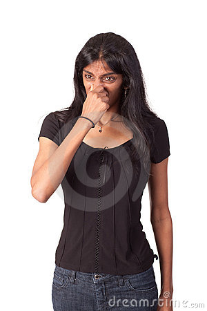 Indian woman pinching her nose closed