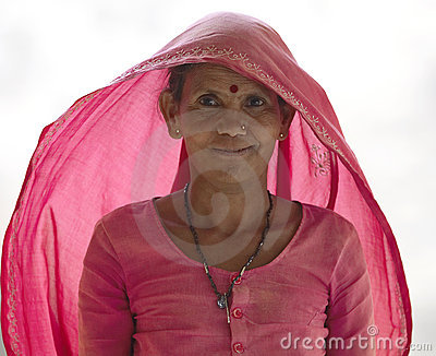 Indian woman in pink dress and shawl - India Editorial Stock Image