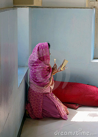 Indian woman praying in church