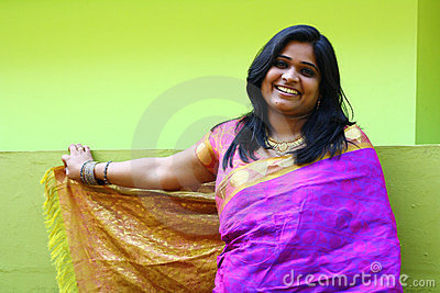 Indian Woman in Purple Saree standing and smiling