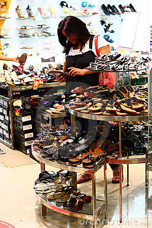 Indian Woman Selecting Footwear in a Retail Outlet