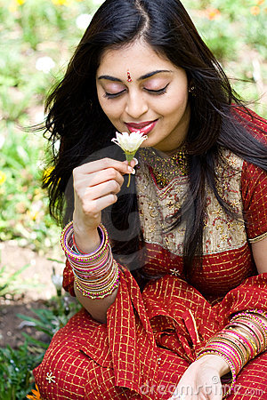Indian woman smell flowers